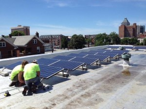 Workers install solar panels at Faith Community Church in Greensboro. Photo provided by NC WARN