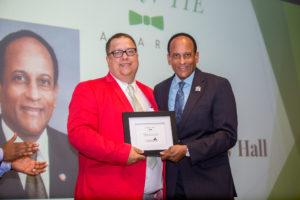 "Dan Crawford poses with Secretary Larry Hall holding a framed award for Secretary Hall's 2017 ""The Joe"" honors"